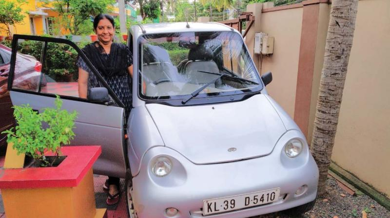 Ranjini Varma with her 8-year old Reva-i electric car (Photo: DC)