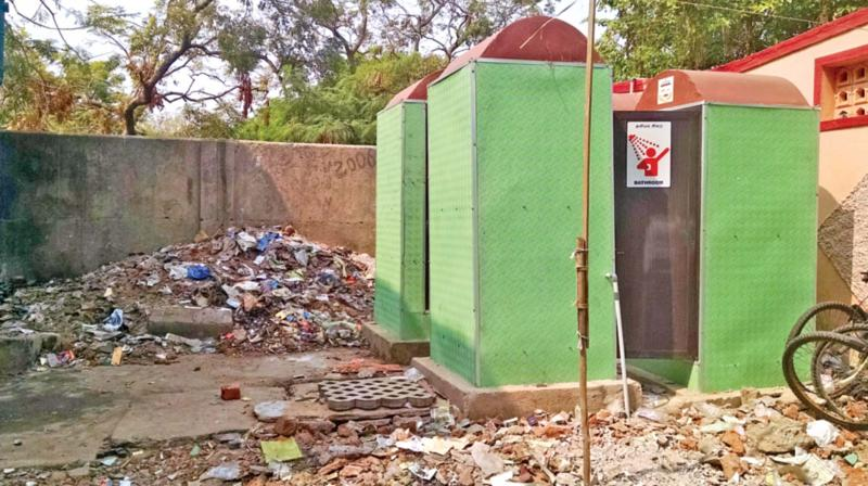 Surrounded by garbage, a public toilet at a fishing village of Besant Nagar remains inaccessible. 	(Photo: DC)
