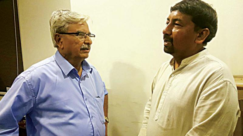 B.S. Anantharam (left) and Mohan Raju feel the city transport authorities should learn from the recent Mumbai stampede to prevent such tragedies in Bengaluru. (Photo: DC)
