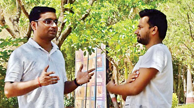 Priyadarshan, a private company employee, and  Ranjeeth, a businessman, in disscussion on tariff hike