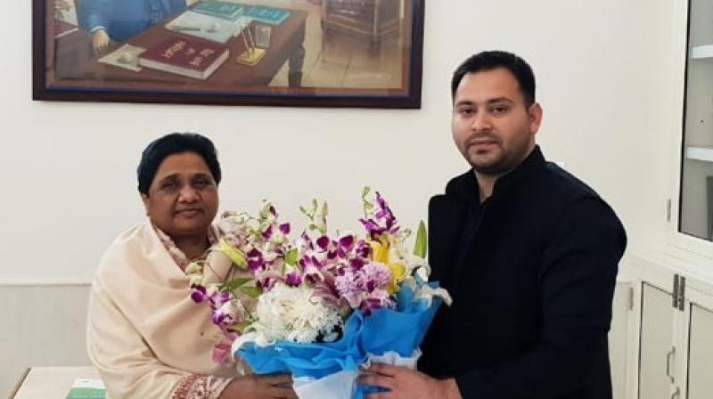 RJD leader Tejashwi Yadav met BSP supremo Mayawati at her residence in Lucknow on Sunday. (Photo: Twitter | @yadavtejashwi)