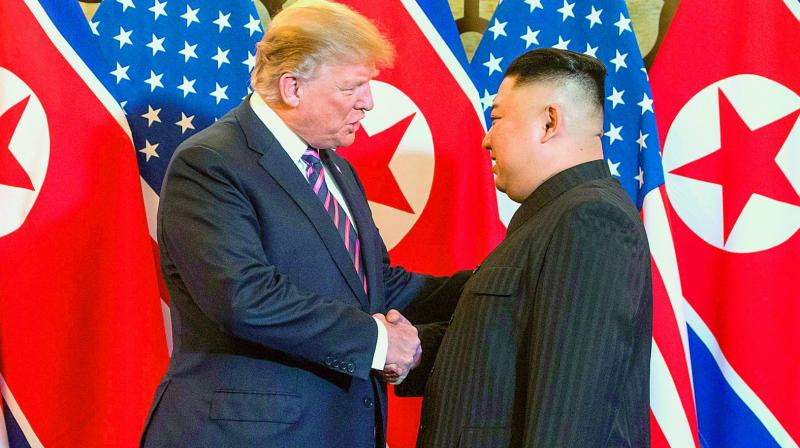 US President Donald Trump shakes hands with North Korea's leader Kim Jong Un before a meeting in Hanoi on Wednesday. (Photo: AFP)