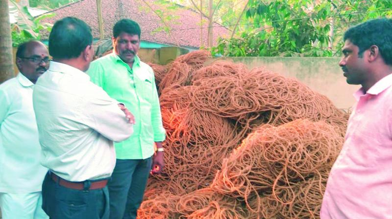 Horticulture officials interact with farmers advising them to use modern machinery to make yarn from coconut husk as, at present, they are using old machinery at Konaseema region. (Photo:  DC)
