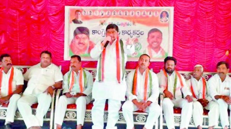 TPCC working president, Ponnam Prabhakar addressing the party cadre in a meeting held here in Husnabad of Karimnagar on Tuesday.  	— DC