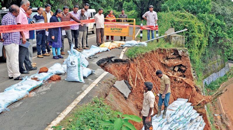 Nilgiris Collector J. Innocent Divya inspects the flood affected Ooty-Kundah road near Merland sector on Tuesday. (Photo: DC)