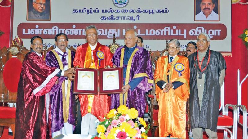 Governor and Chancellor of Tamil University conferring D.Litt (honoris causa) on Armoogam Parsuramen, former minister of Mauritius and founder president of International Thirukural Foundation at the convocation at Tamil University at Thanjavur on Tuesday. K.Pandiarajan, state minister for Tamil official language also seen. (Photo: DC)