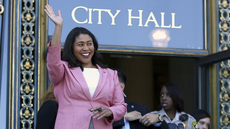 In this June 13, 2018, file photo, London Breed waves before speaking to reporters outside of City Hall in San Francisco. (Photo: AP)