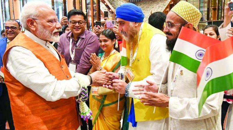 Prime Minister Narendra Modi is welcomed by the Indian community in Bangkok on Saturday. (Photo: PTI)