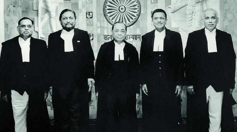 Five Supreme Court judges — Chief Justice of India Ranjan Gogoi (centre) flanked by Justice Ashok Bhushan (left), Justice Sharad Arvind Bobde (second from left), Justice Dhananjaya Y. Chandrachud (second from right), Justice S. Abdul Nazeer (right) — pose for a photograph after delivering the verdict on Ayodhya land case in New Delhi. (Photo: PTI)