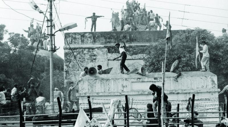 Hindu activists climb up the dome of Babri Masjid in Ayodhya which was quickly demolished by end of the day. (Photo: Sondeep Shankar)