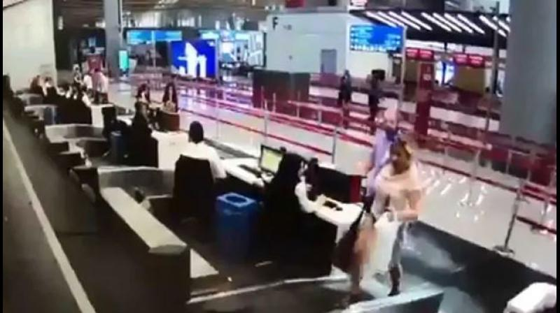 CCTV footage showed the woman checking in her luggage at the counter. After that, instead of heading towards the terminal, she stepped onto the luggage belt even as people around her looked puzzled. (Photo: Screengrab)