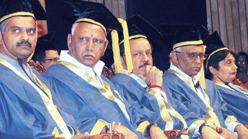 Chief Minister B.S. Yediyurappa (from L), Union Minister for Health and Family Welfare Dr Harsh Vardhan and Director NIMHANS Dr B.N. Gangadhar at the 24th Convocation of National Institute of Mental Health and Neuro Sciences at NIMHANS convention centre in Bengaluru on Monday (Photo: KPN)