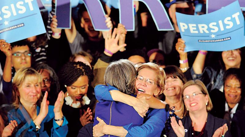 Senator Elizabeth Warren embraces Congresswoman Katherine Clark before she addresses the audience in Boston, Massachusetts  (Photo: AFP)