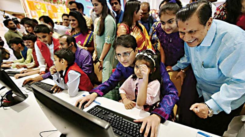 Stockbrokers trades as their family watch during a special 'muhurat' trading session for Diwali at BSE in Mumbai, on Wednesday.