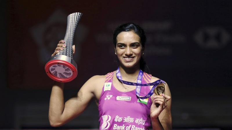 Sindhu, after winning the World Tour Finals championship, became the first Indian ever to get hold of the prestigious championship. (Photo: AP)