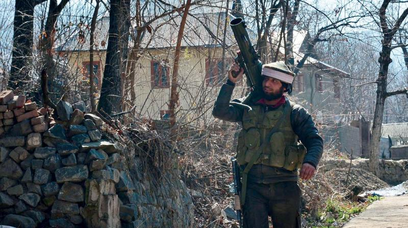 A jawan carries a rocket launcher used in the 15-hour encounter at Hafoo Nazneenpora village of Tral in Kashmir's Pulwama district on Sunday. (Photo: DC)