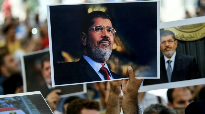"""Foreign ministry spokesman Ahmed Hafez said he condemned """"in the strongest terms"""" the call by the spokesman for the UN High Commissioner for Human Rights, Rupert Colville, for an independent investigation into Morsi's death during a court hearing on Monday. (Photo: AFP)"""