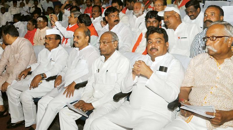 Ministers M.B. Patil and Sharan Prakash Patil and MP Prakash Hukkeri at a seminar on religion status for Lingayats in Bengaluru on Thursday. (Photo: DC)