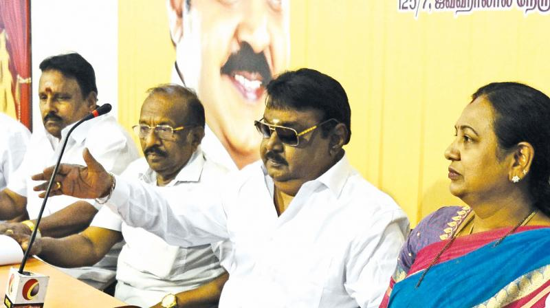 Vijayakanth and Premalatha Vijayakanth at DMDK district secretaries meeting in Chennai on Thursday.   (DC)