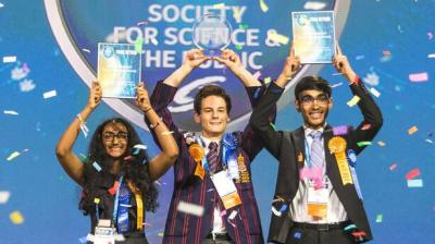 From left: Meghana Bollimpalli, Oliver Nicholls and Dhruvik Parikh celebrate on Friday, May 18, 2018, at the 2018 Intel International Science and Engineering Fair, a program of Society for Science & the Public and the world's largest international pre-college science competition. Nicholls, of Sydney, Australia, was awarded first place for designing and building a prototype of an autonomous robotic window cleaner for commercial buildings. Bollimpalli, of Little Rock, Arkansas, and Parikh, of Bothell, Washington, received Intel Foundation Young Scientist Awards. (Credit: Intel Corporation)