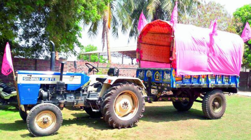 A tractor waits, all decked up to canvass the April 27 TRS public meeting in villages in Warangal district on Monday.