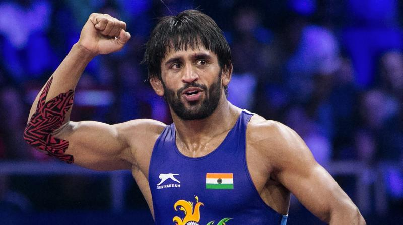 Bajrang Punia's frustrated coach Shako Banitidis kicked the coach's block in anger, protesting the partisan officiating during the 65kg bout, which ended 9-9 after a nerve-wracking six minutes. (Photo: PTI)