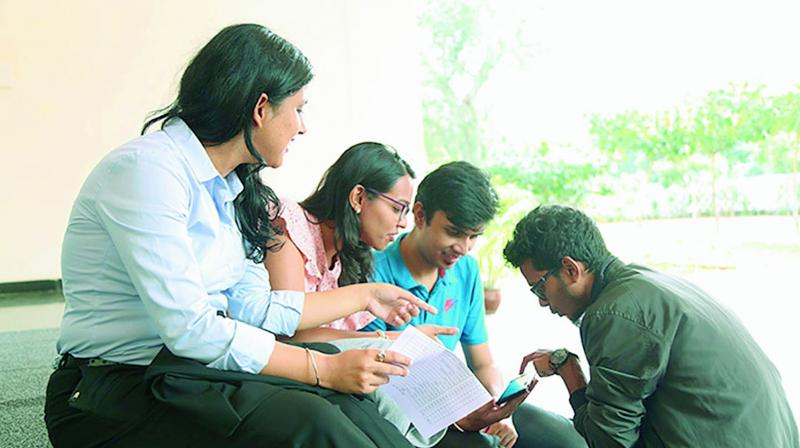 Students of IIM-V in a discussion after they were selected for the summer internship in Vizag on Monday. (Photo DC)