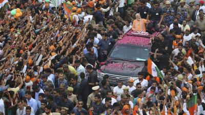Indian Prime Minister Narendra Modi greets the crowd during a road show in Varanasi, India. (Photo:AP)