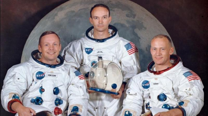 The crew of the Apollo 11, Neil Armstrong (L), commander; Michael Collins (C), module pilot; Edwin E.