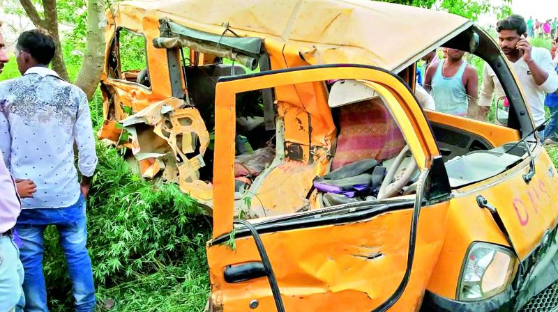 People gather around the mangled school van after it collided with a moving train in Kushinagar, Uttar Pradesh, on Thursday morning. (Photo:PTI)