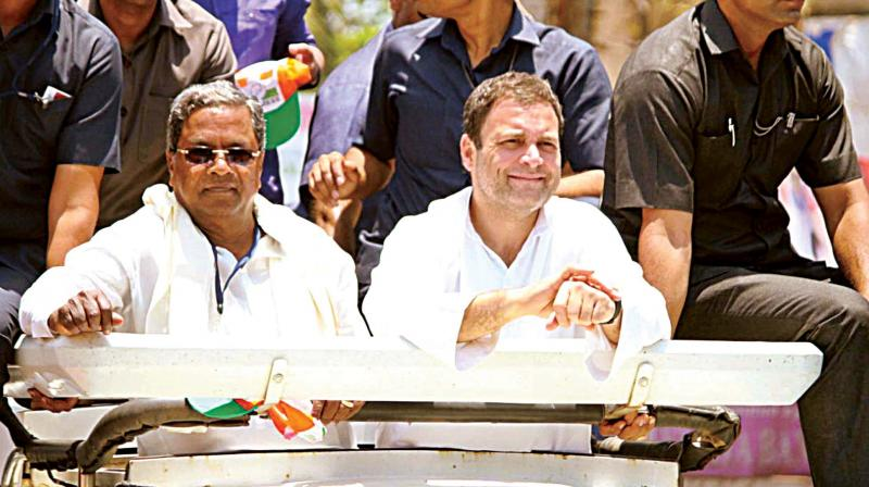 AICC president Rahul Gandhi and Chief Minister Siddaramaiah during election campaign at Ankola on Thursday. (Photo:KPN)