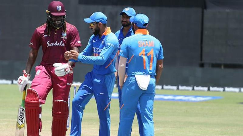 As wet-outfield continued to delay the ongoing first ODI of the three-match series between India and West Indies, Indian skipper Virat Kohli found a way to pass time as he put on his dancing shoes.  Accompanying Kohli was his former RCB teammate and Windies batsman Chris Gayle. (Photo:BCCI/Twitter)