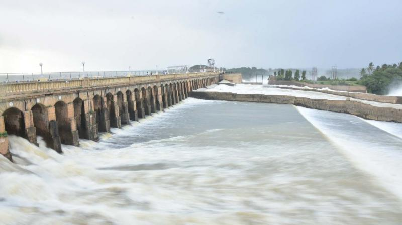 Water released from all the gates of KRS reservoir in Mandya on Sunday (Photo: KPN)