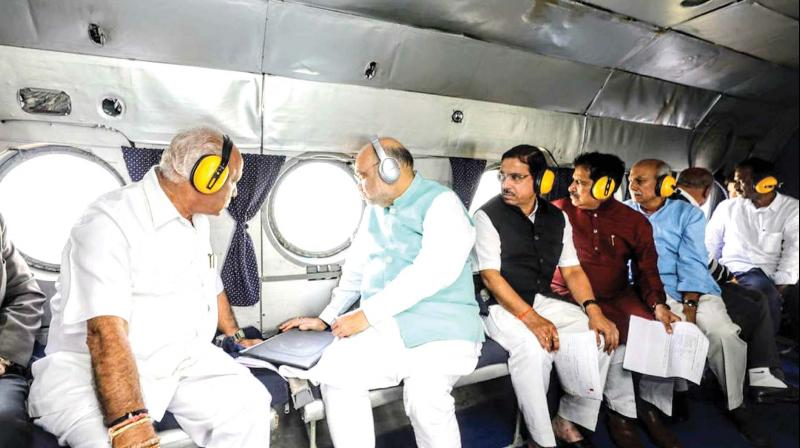 Union Home Minister Amit Shah conducts an aerial survey of flood-hit areas of Belagavi on Sunday (Photo: KPN)