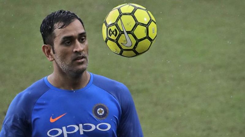 During the rain effected 3rd T20 match between India and New Zealand MS Dhoni decided to spend time by playing match of footvolley. (Photo:AP)