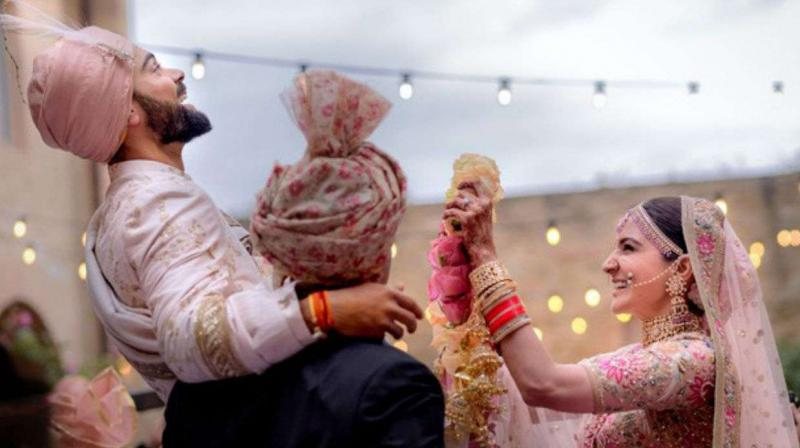 Virat Kohli and Anushka Sharma shared their wedding picture on Twitter to make official announcement of their wedding  . (Photo: Twitter/ Virat Kohli)
