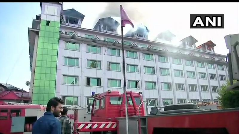 The fire broke out at Hotel Pamposh near Regal Chowk in the heart of the city here, a police official said. (Photo: ANI/Twitter)