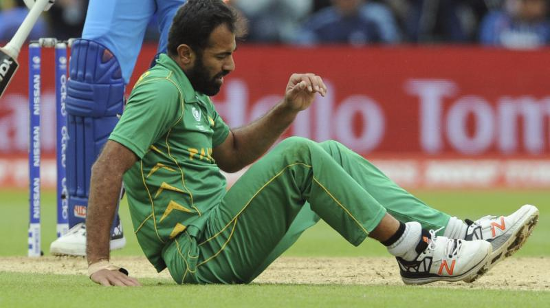 The 31-year-old Wahab Riaz sustained the injury whilst bowling during his side's crushing 124-run defeat against arch-rivals India at the Edgbaston Cricket Ground in Birmingham on Sunday.(Photo:AP)