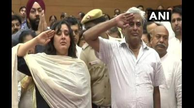 Sushma Swaraj's daughter Bansuri Swaraj and husband Kaushal Swaraj saluted her amidst a swarm of leaders cutting across party ranks and files. People from all walks of life thronged the BJP headquarters in the national capital to get a last glimpse of the former Foreign Minister. (Photo: ANI)