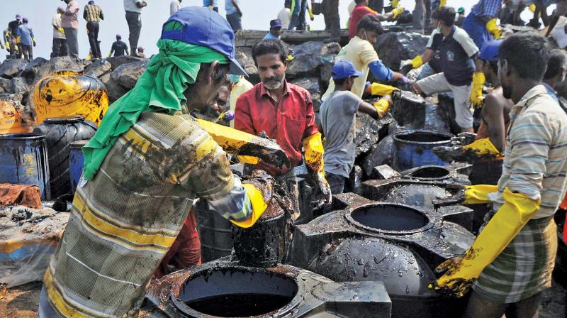 Volunteers pour the sludge into tanks at Ernavur. (Photo: DC)