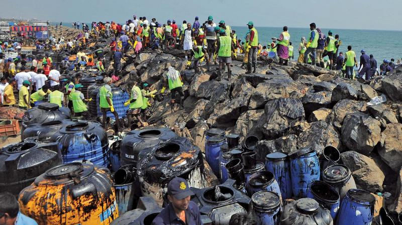 Volunteers and staff from various government departments on Saturday join hands to clear the oil spill. (Photo: DC)