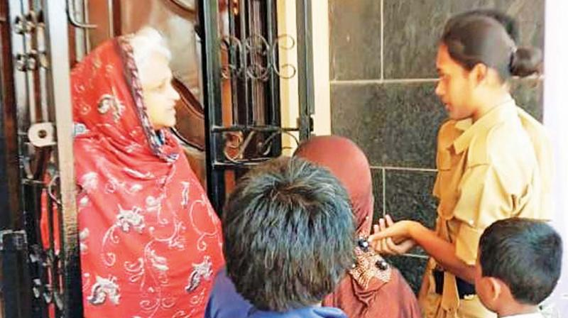 The NCC cadets of Providence College for Women at Coonoor talk to a housewife during a door-to-door  campaign on e-waste management.(Photo: DC)