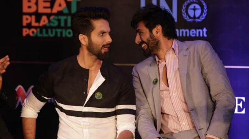 Shahid Kapoor and Kartik Aaryan at an event.