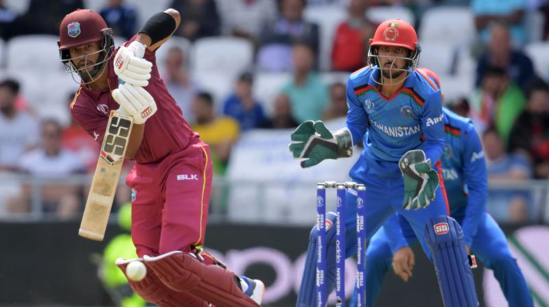 Opener Evin Lewis celebrated his return to the team with 58 and Nicholas Pooran also made 58, his third 50-plus score of the tournament. (Photo: AFP)