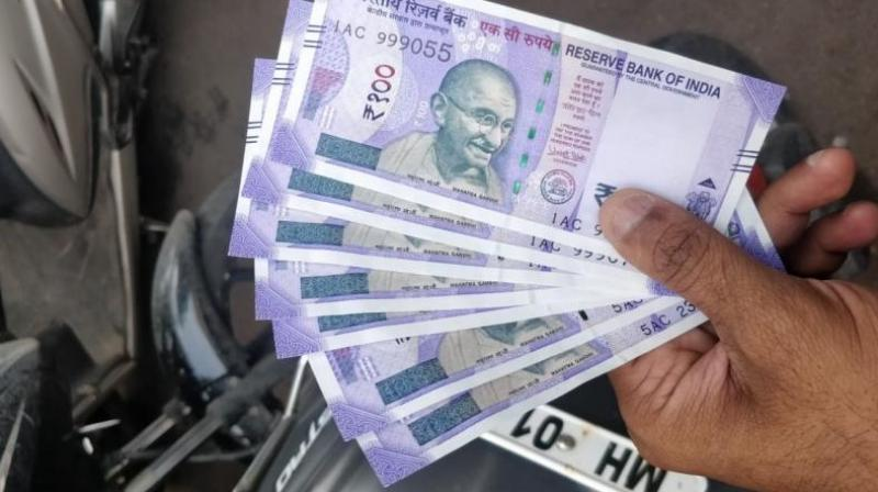 The rupee on Friday surged by another 34 paise to close at a one-week high of 71.84 against the US dollar on positive macro data and hopes of policy intervention by the government to defend the volatile currency. (Photo: DC)