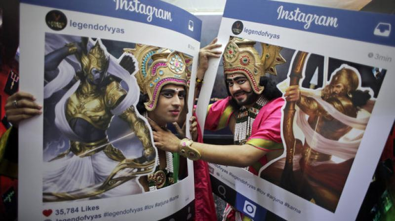 Fans dressed as Hindu mythological characters pose for photographs at Delhi Comic Con in New Delhi, India, Saturday, Dec. 5, 2015. (Photo: AP)