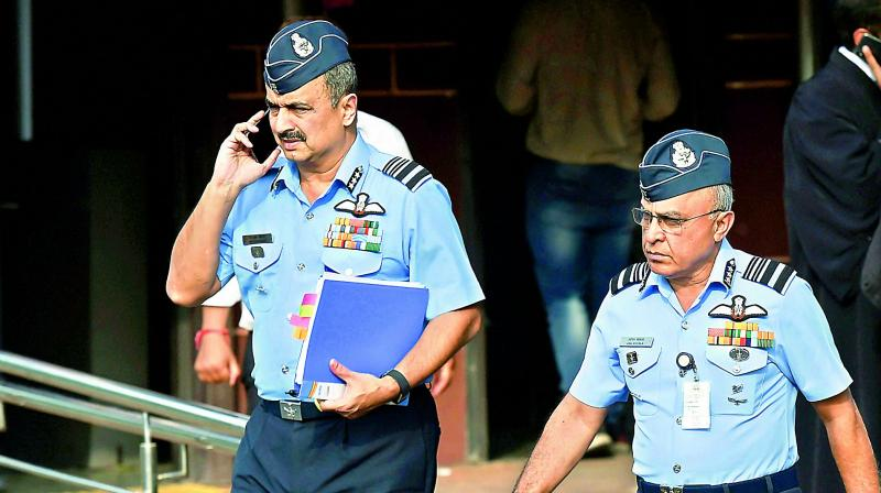 Deputy chief of air staff Air Marshal V.R. Chaudhari with Air Marshal Anil Khosla (R) leave the Supreme Court after a hearing on Rafale Deal on Wednesday. (PTI)