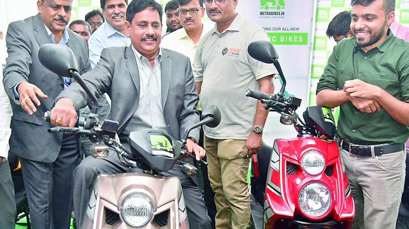 Metro e-bikes are going to be given to citizens from August 15 in Metro stations of Hyderabad and the bikes were introduced by managing director N.V.S. Reddy at Ameerpet station on Monday.  (Photo:S. Surender Reddy)