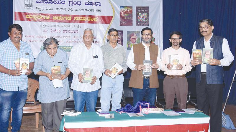 Literateur Vivek Shanbbhag releases the book Meese Maava, authored by Deccan Chronicle, Bengaluru Chief of Bureau Bhaskar Hegde (2nd R) in Dharwad on Wednesday (Photo: DC)