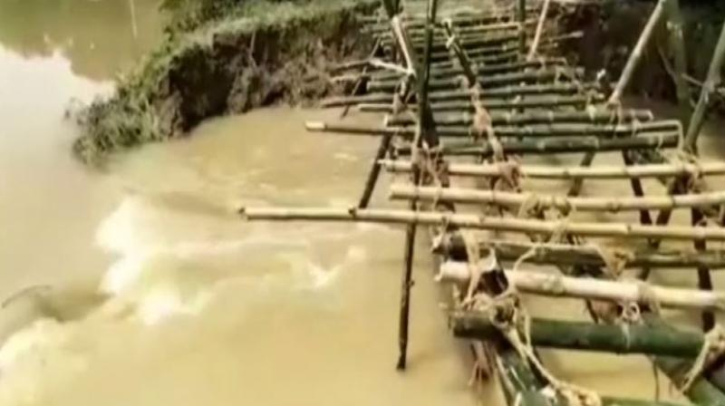Heavy downpour in the state has also made the lives of locals in Dangi Tola village difficult.  (Photo: ANI)